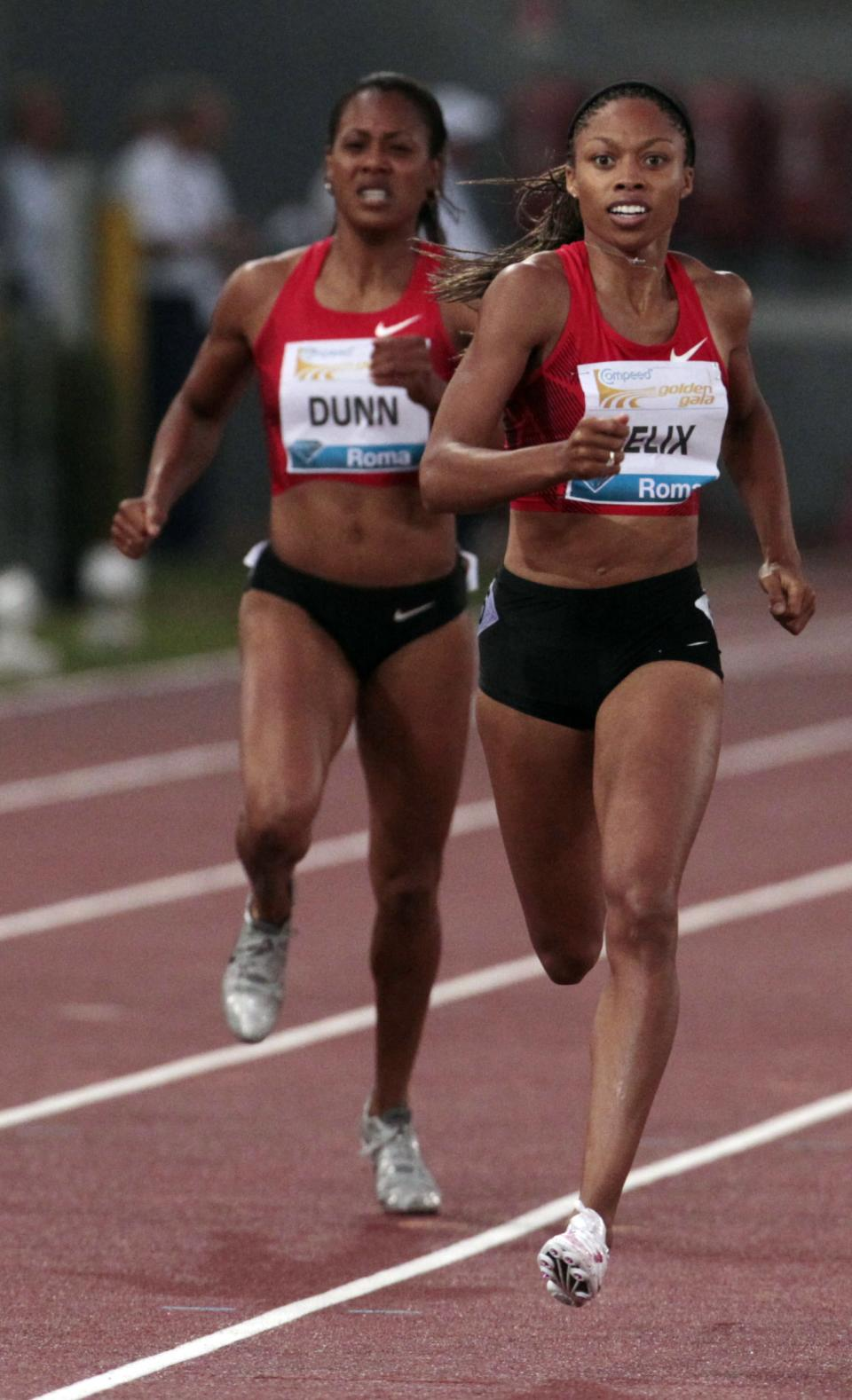 U.S. Allyson Felix, right, competes on her way to win the women's 400m event at the Golden Gala athletics meeting, in Rome, Thursday, May 26, 2011. (AP Photo/Gregorio Borgia)
