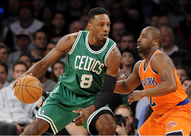 Boston Celtics' Jeff Green (8) drives the ball against New York Knicks' Raymond Felton (2) during the first half of an NBA basketball game on Sunday, Dec. 8, 2013, in New York. The Celtics won