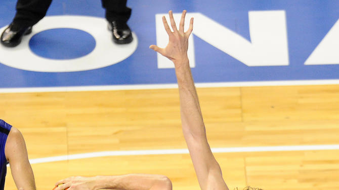 Kevin Love of the US Men's Senior National Team, left, dives for the ball against Pau Gasol of Spain Men's Senior National Team during an exhibition match between Spain and the United States Tuesday, July 24, 2012, in Barcelona, Spain, in preparation for the 2012 Summer Olympics. (AP Photo/Manu Fernandez)