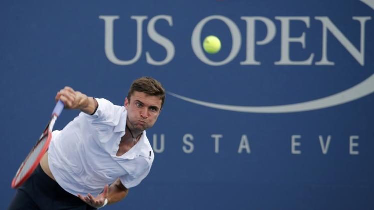 Simon of France serves to Cilic of Croatia during their fourth round match at the 2014 U.S. Open tennis tournament in New York