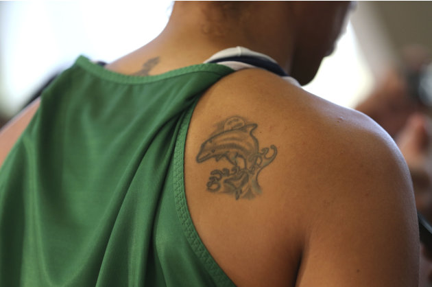 The tattoo of Erika of Brazil's women's basketball team is seen during a team practice session in the Crystal Palace in London
