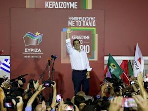 Former Greek prime minister and leader of leftist Syriza party Alexis Tsipras waves to supporters after winning general election in Athens