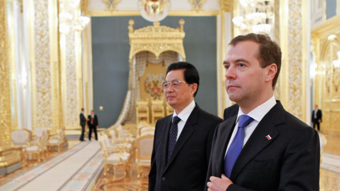 Russian President Dmitry Medvedev,  right, and Chinese President Hu Jintao walk after their talks in the Moscow's Kremlin during the official visit, Russia, Thursday, June 16, 2011. The leader of China, the most populated country in the world, arrived in neighboring Russia, the largest country in the world, on Wednesday. The Chinese leader Hu Jintao flew to Moscow for talks with Russian leaders. (AP Photo/RIA-Novosti, Dmitry Astakhov, Presidential Press Service)