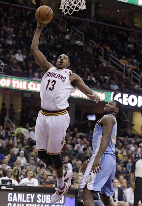 Cleveland Cavaliers' Tristan Thompson (13), from Canada, jumps to the basket against Denver Nuggets' Kenneth Faried (35) during the second quarter of an NBA basketball game on Wednesday, Dec.