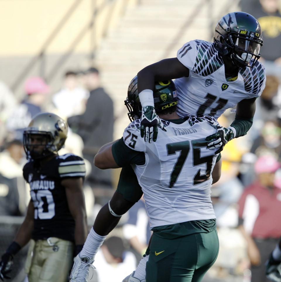 Mariota's 7 TDs lead No. 2 Oregon over Buffs 57-16
