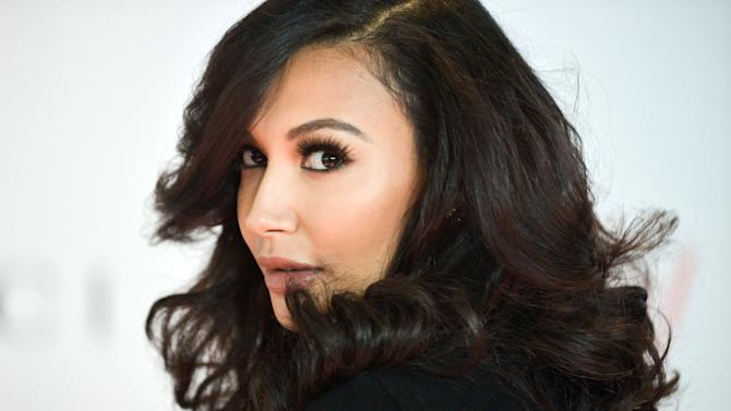 File- This Dec. 11, 2013, file photo shows Naya Rivera arriving at the 22nd Annual Women in Entertainment Breakfast at the Beverly Hills Hotel in Beverly Hills, Calif. Rivera is still a Gleek. FOX Network said in a statement to the AP on Saturday that there's no truth to rumors that Rivera had been fired from the show. Rivera plays the character Santana Lopez, a lesbian glee club member, on the popular musical drama. (Photo by Richard Shotwell/Invision/AP, File)