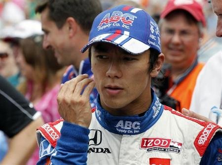A.J. Foyt Enterprises driver Takuma Sato of Japan walks down pit lane after qualifying for the Indianapolis 500 at the Indianapolis Motor Speedway in Indianapolis