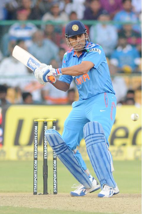 Indian captain M S Dhoni in action during the 7th ODI between India and Australia played at Chinnaswamy Stadium in Bangalore on Nov.2, 2013. (Photo: IANS)