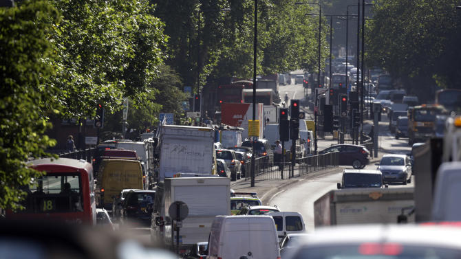 Motorists head into central London during the morning rush hour on the first week-day of full competition of the 2012 Summer Olympics, Monday July 30, 2012. (AP Photo/Lefteris Pitarakis)