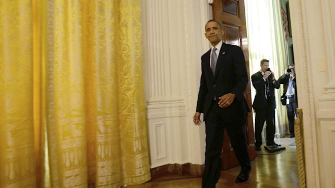 President Barack Obama arrives in the East Room of the White House in Washington, Wednesday, Nov. 14, 2012, for his first post election day news conference. (AP Photo/Jacquelyn Martin)