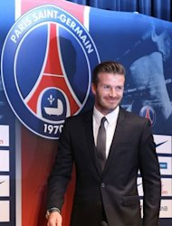 British football player David Beckham arrives for a press conference at the Parc des Princes stadium in Paris on January 31, 2013 to announce that he joined Paris Saint-Germain (PSG) football club. Beckham signed a five-month deal with the Ligue 1 leaders until the end of June, the club said.