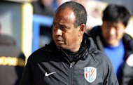 Shanghai Shenhua&#39;s French coach Jean Tigana, seen in February 2012, has quit the club, Chinese state media said Monday. In response, Tigana has denied the media reports about his quitting, but declined to confirm whether or not he was still at the club