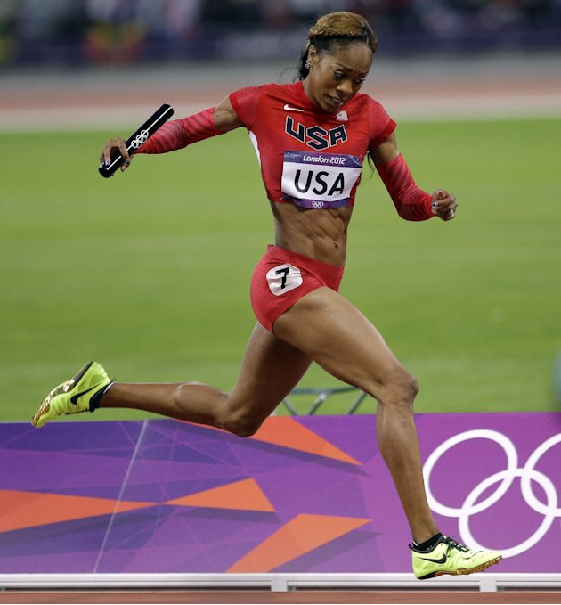 USA's Sanya Richards-Ross heads to the finish line to win the gold medal in the women's 4x400-meter during the athletics in the Olympic Stadium at the 2012 Summer Olympics, London, Saturday, Aug. 11, 