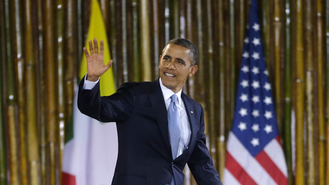 U.S. President Barack Obama waves as he is introduced before speaking at Yangon University's Convocation Hall in Yangon, Myanmar, Monday, Nov. 19, 2012. (AP Photo/Pablo Martinez Monsivais)