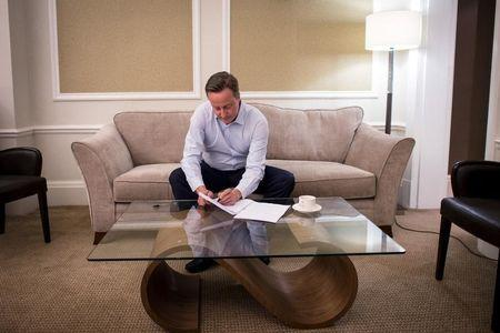 Prime Minister Cameron is seen in his hotel room as he prepares for his speech for the Conservative Party Conference in Manchester