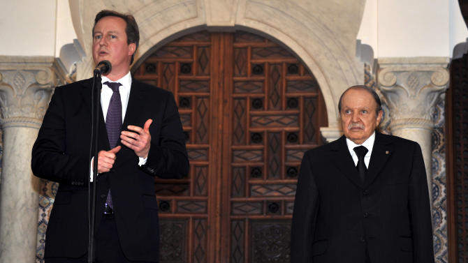 Algerian President Abdelaziz Bouteflika, right, listens to Britain's Prime Minister David Cameron as he delivers a speech in Algiers, Wednesday, Jan. 30, 2013. Britain and Algeria agreed to a security partnership that could see greater intelligence-sharing and planning for future crises, Cameron said Wednesday on a visit to the North African country. (AP Photo/Anis Belghoul)