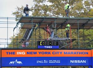 Workers build a media stand at the finish line of the…