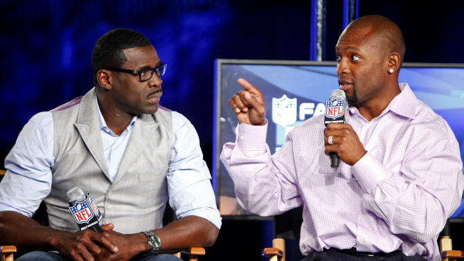 Former NFL players Michael Irvin and Ahman Green are seen during the DirecTV NFL Fantasy Week on Wednesday, Aug. 22, 2012 at the Best Buy theatre in Times Square in New York. (Photo by Brian Ach/AP Images for NFL)