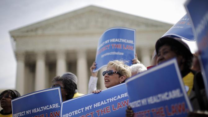 FILE - In this March 28, 2012 file photo, supporters of health care reform rally in front of the Supreme Court in Washington on the final day of arguments regarding the health care law signed by President Barack Obama. Arguments in the Supreme Court failed to yield clear hints how the justices would rule on the question of whether President Barack Obama's health care overhaul would be left standing if the high court were to strike down the linchpin provision that all Americans must have health insurance.  (AP Photo/Charles Dharapak, File)