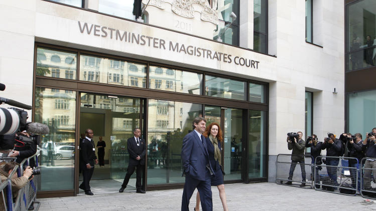 Rebekah Brooks, right, former chief executive of News International and her husband Charlie Brooks leave Westminster Magistrates' Courts after they were granted bail following their appearance to face charges of conspiracy to pervert the course of justice, London, Wednesday, June 13, 2012. (AP Photo/Sang Tan)