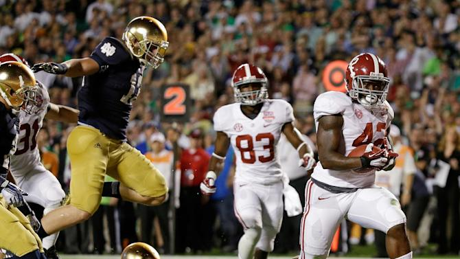 Alabama's Eddie Lacy (42) breaks away for a touchdown run during the first half of the BCS National Championship college football game against Notre Dame Monday, Jan. 7, 2013, in Miami. (AP Photo/David J. Phillip)