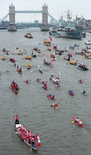 Boats row towards London bridge during the Thames Diamond Jubilee Pageant