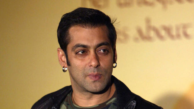 """FILE – In this July 17, 2007 file photo, Bollywood superstar Salman Khan poses during the soundtrack release of the film """"Marigold"""" in Mumbai, India. An Indian court will try five Bollywood actors, including Khan, for allegedly killing two rare deer in a western India wildlife preserve 14 years ago. (AP Photo/Gautam Singh, File)"""