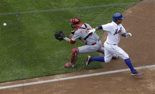 Phillips' strange double lifts Reds over Mets 7-4