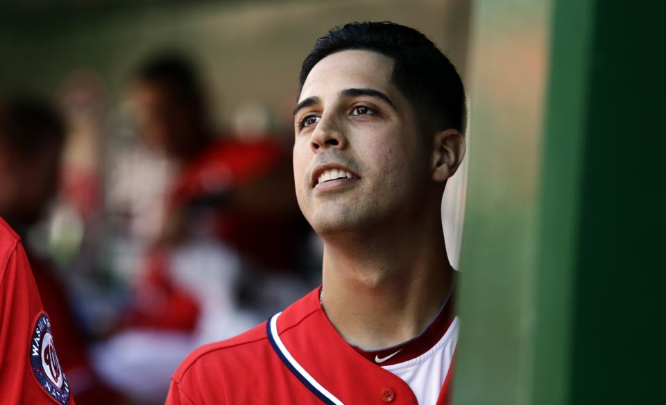 Washington Nationals starting pitcher Gio Gonzalez pauses in the dugout during a baseball game against the Milwaukee Brewers at Nationals Park Saturday, Sept. 22, 2012, in Washington. It was Gonzalez's 20th win of the season, and the Nationals won 10-4. (AP Photo/Alex Brandon)
