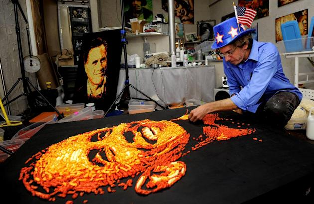 IMAGE DISTRIBUTED FOR CHEETOS - Artist Jason Baalman puts the finishing touches on a Cheetos portrait of President Barack Obama Tuesday, Oct. 2, 2012, in Baalman's Colorado Springs, Colo., studio.  To