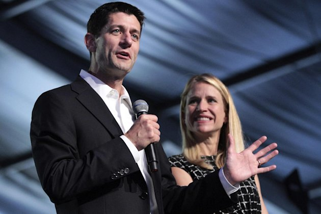 Republican vice presidential candidate, Rep. Paul Ryan, R-Wis., and wife Janna appear on stage at the Wisconsin delegation's Beers and Brats event, Wednesday, Aug. 29, 2012, in Tampa, Fla. (AP Photo/Mary Altaffer)