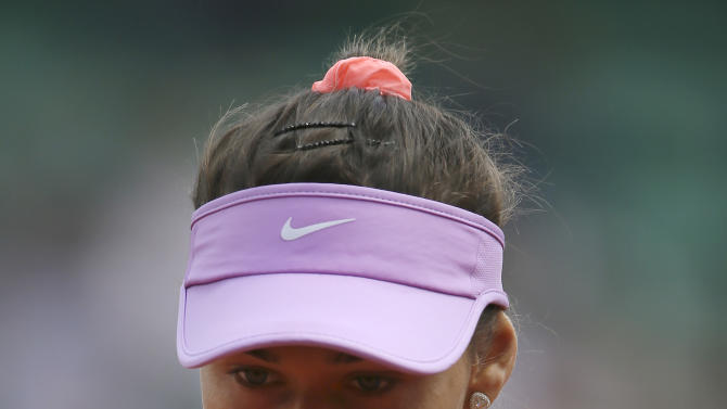 Vitalia Diatchenko of Russia reacts as she plays compatriot Maria Sharapova during their second round match of the French Open tennis tournament at the Roland Garros stadium, Wednesday, May 27, 2015 in Paris,  (AP Photo/David Vincent)