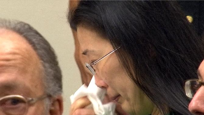 Trianle Li weeps after speaking in Judge Michael Toto's courtroom at State Superior Court in New Brunswick, NJ, Monday, Sept. 30, 2013, after she was sentenced to life in prison for the poisoning murder of her husband. Tianle Li won't be eligible for parole for more than 62 years for the killing of Xiaoye Wang, a computer software engineer, in early 2011. The 42-year-old Li was convicted in July of murder and hindering apprehension. She continues to deny any role in her husband's death, said her attorney, Steven Altman. (AP Photo/Home News Tribune, Thomas P. Costello, Pool)