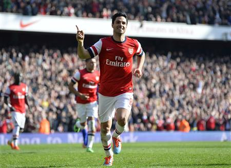 Arsenal's Arteta celebrates after scoring a penalty against Everton during their English FA Cup quarter final soccer match at the Emirates stadium in London