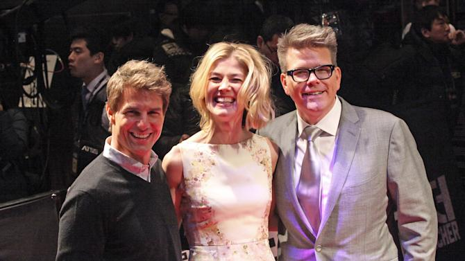 """U.S. actor Tom Cruise, left, British actress Rosamund Pike and director Christopher McQuarrie, right, pose for photographers before a premiere of their new movie """"Jack Reacher"""" at the Busan Cinema Center in Busan, South Korea, Thursday, Jan. 10, 2013. (AP Photo/Ahn Young-joon)"""