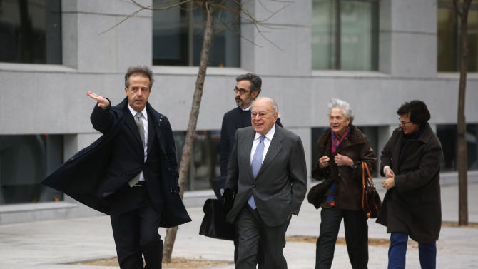 Former Catalan regional president Jordi Pujol and his wife Marta Ferrusola arrive to appear before a judge at the High Court in Madrid