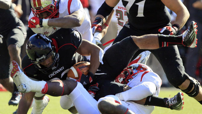 Cincinnati running back George Winn (32) is stopped after a short gain against Rutgers during the first half of an NCAA college football game, Saturday, Nov. 17, 2012, in Cincinnati. (AP Photo/Al Behrman)