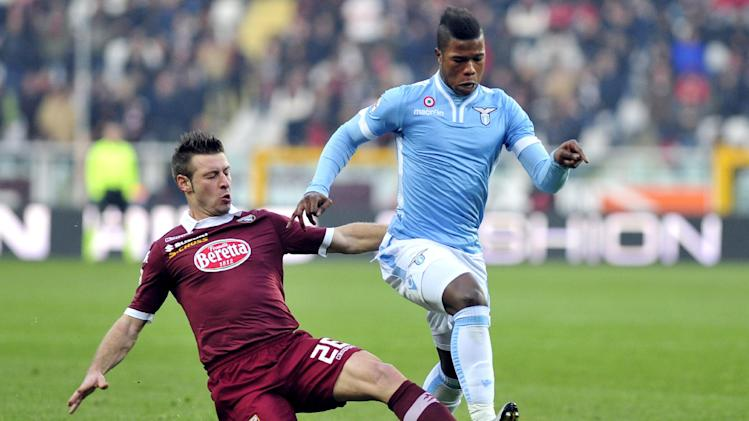 Lazio forward Balde Diao Keita of Spain is challenged by Torino defender Giovanni Pasquale during a Serie A soccer match between Torino and  Lazio at the Olympic stadium, in Turin, Italy, Sunday, Dec. 8, 2013