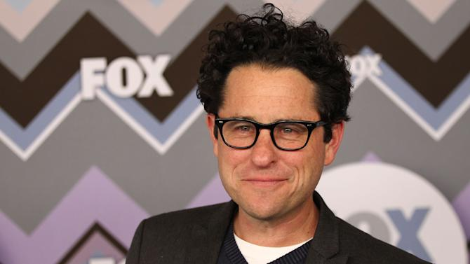 "FILE - In this Jan. 8, 2013 file photo, J.J. Abrams arrives at the Winter TCA Fox All-Star Party at the Langham Huntington Hotel in Pasadena, Calif. Abrams is set to direct the next installment of ""Star Wars,"" which Disney has said will be ""Episode 7"" and due out in 2015. Disney bought ""Star Wars"" maker Lucasfilm last month for $4.06 billion.  (Photo by Matt Sayles/Invision/AP, File)"