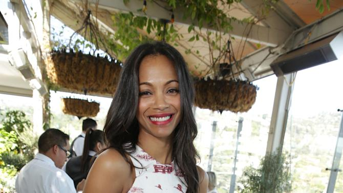 FILE - This Wednesday, March 13, 2013 publicity photo provided by The Hollywood Reporter shows Zoe Saldana at The Hollywood Reporter and Jimmy Choo Celebration of the Most Powerful Stylists in Hollywood, in Los Angeles. (AP Photo/The Hollywood Reporter, Eric Charbonneau)