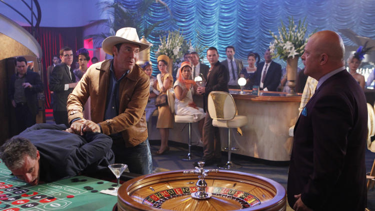 "This image released by CBS shows Dennis Quaid, left, and Michael Chiklis in a scene from the new CBS series, ""Vegas,""  premiering Tuesday, Sept. 25, at 10 p.m. ET/PT. (AP Photo/CBS, Monty Brinton)"