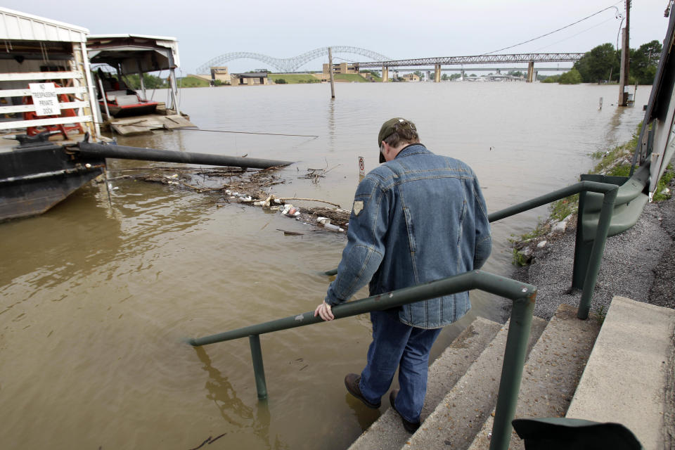 Steve Scheer looks at floodwater Saturday, May 7, 2011, in Memphis, Tenn. Communities all along the banks of the Mississippi are keeping a close eye on the river's rise with the crest in Memphis not expected until Wednesday. (AP Photo/Jeff Roberson)