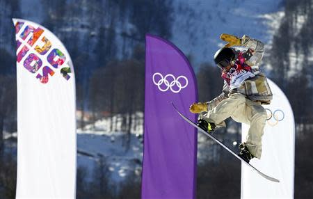 Sage Kotsenburg of the U.S. performs a jump during the men's snowboard slopestyle final at the 2014 Sochi Olympic Games in Rosa Khutor