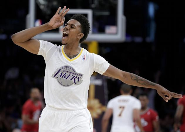 Los Angeles Lakers forward Nick Young celebrates a 3-point basket against the Miami Heat during the second half of an NBA basketball game in Los Angeles, Wednesday, Dec. 25, 2013. The Heat won 101-95