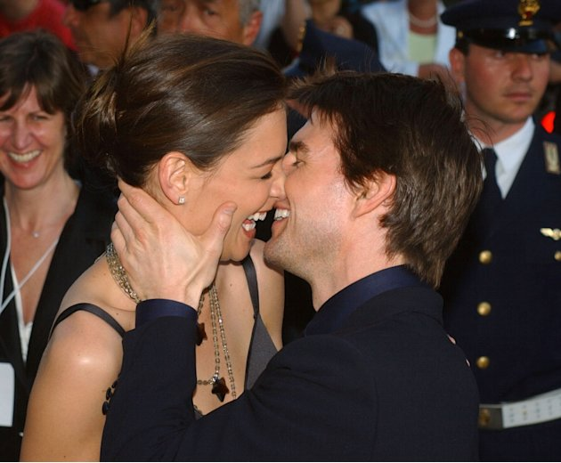 FILE - In this Friday April 29, 2005 file photo,Tom Cruise, right, and Katie Holmes laugh as they on Via della Conciliazione Boulevard near St. Peter's Basilica, as they arrive at the St. Cecilia audi
