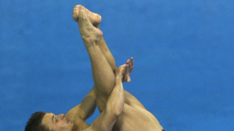 Bronze medalists Kristian Ipsen, front, and Troy Dumais, rear, from the US compete during the men's synchronized 3-meter springboard diving final at the Aquatics Centre in the Olympic Park during the 2012 Summer Olympics in London, Wednesday, Aug. 1, 2012. (AP Photo/Michael Sohn)