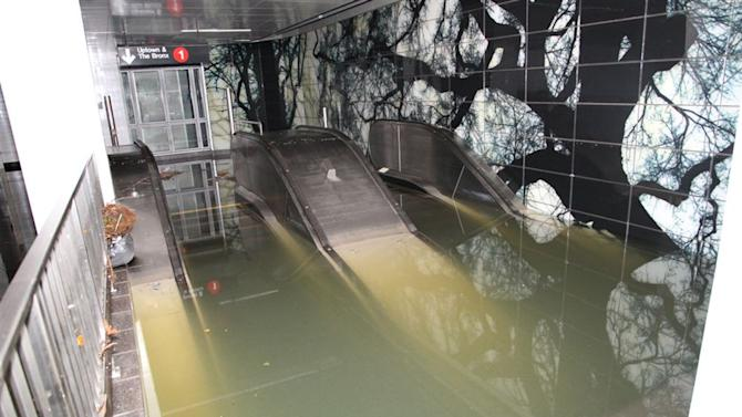 FILE - In this Oct. 30, 2012 file photo provided by New York's Metropolitan Transportation Authority, floodwaters rise above the top stair of an escalator in New York City's South Ferry station in the wake of Superstorm Sandy. More than three decades before Sandy, a state law and a series of legislative reports began warning New York politicians to prepare for a storm of historic proportions, spelling out scenarios eerily similar to what actually happened. (AP Photo/Metropolitan Transportation Authority, File)