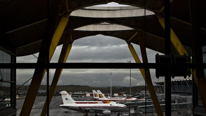 """Iberia jets are seen in a parking zone at Barajas international airport in Madrid, Friday, Nov. 9, 2012. International Airlines Group on Friday warned that its Spanish carrier Iberia was """"in a fight for survival"""" and unveiled a restructuring plan to cut 4,500 jobs as it reported a drop in third-quarter profit. (AP Photo/Daniel Ochoa de Olza)"""