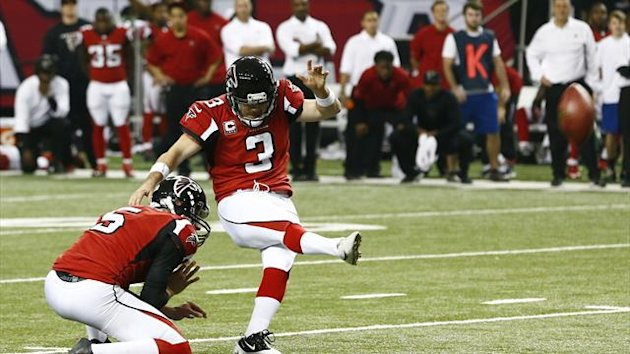 Atlanta Falcons kicker Matt Bryant (R) kicks the winning field goal with holder Matt Bosher to defeat the Seattle Seahawks in their NFL NFC Divisional playoff football game