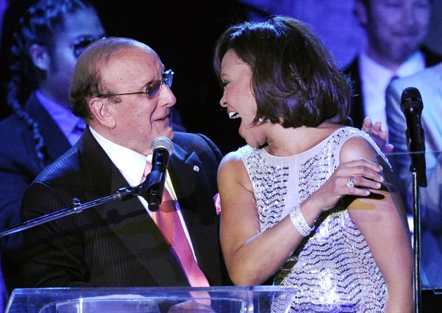 FILE - This Feb. 13, 2011 file photo shows music producer Clive Davis with singer Whitney Houston at the pre-Grammy gala & salute to industry icons with Clive Davis honoring David Geffen in Beverly Hills, Calif. Last year, Whitney Houston died hours before Clive Davis' annual pre-Grammy gala went on. This year, the music executive says she'll be remembered. Davis' gala will take place Saturday, Feb. 9, 2013, at the Beverly Hilton, where Houston died on Feb. 11, 2012 at age 48. (AP Photo/Mark J. Terrill, file)